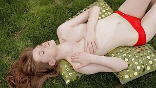 Horny redhead teen fingering in nature