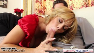 Lustful cougar Amber Lynn Bach taking a large shaf