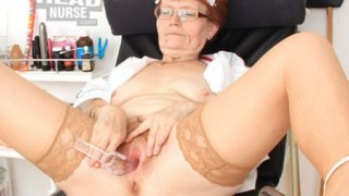 Head nurse practitioner in glasses teases her muff