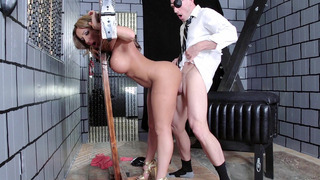 Richelle Ryan getting pounded doggy style in a pillory