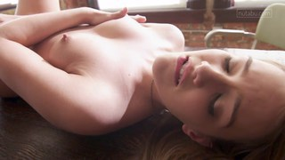 Teen Kenna has an intimate orgasm on a table