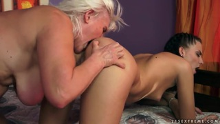Younger girl Judi is being tought  by an old woman