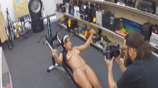 Muscle babe gets nude in pawn shop