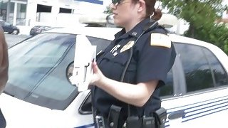 Two female cops take turns on a large black penis in a back of a truck